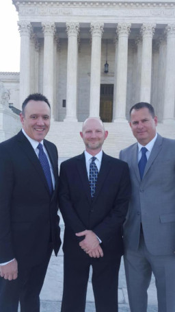 Brian Walsh, Brandon Banks, and Chip Johnson in front of U.S. Supreme Court building after joining Supreme Court Bar